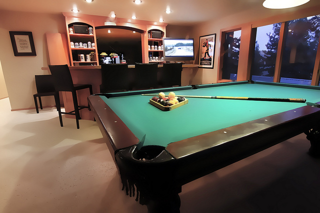 Clean man cave layout with the must have furniture