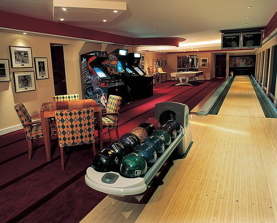 Private bowling alley located in this man cave with arcade games and billiard table