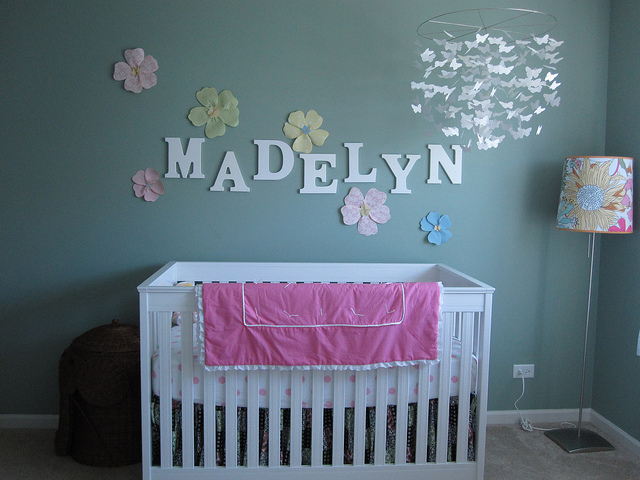 Idea for girl's nursery with name decor and floral wall decals