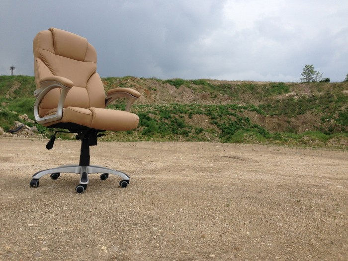 a lonely office chair in the middle of nowhere